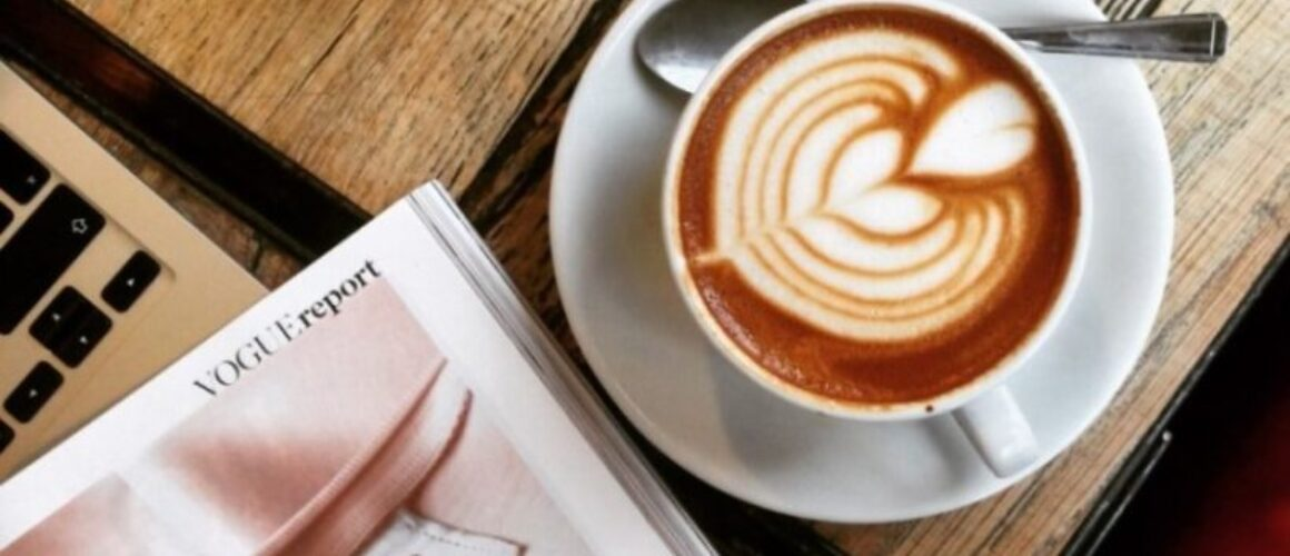 picture of coffee and table and Vogue magazine - bloggers work from coffee shop